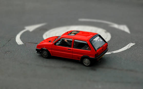 Red Car in Roundabout. by Rob Huntley
