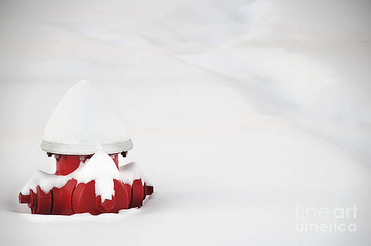 Oscar Gutierrez - Red fired hydrant buried in the snow.