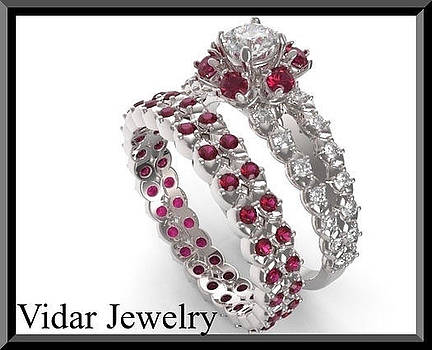 Red Ruby And Diamond 14k Halo Wedding Ring And Engagement Ring Set by Roi Avidar
