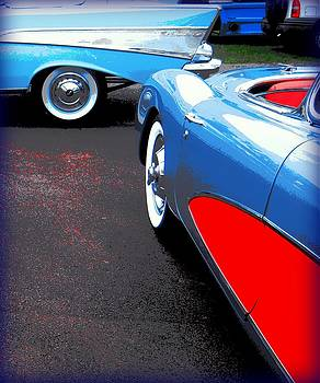 Red Splashed Asphalt with Two Chevrolets by Don Struke