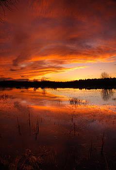 Red sunset over Massabesic Lake by Sebastien Coursol