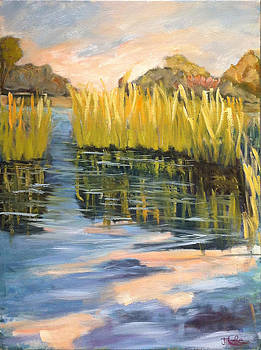 Reeds Reflecting In Water by Jude Lobe