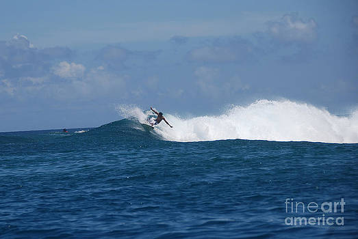 Reef surfer Moorea by Camilla Brattemark