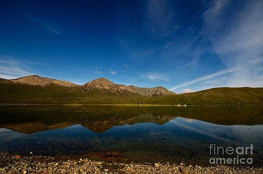 Reflection of Mountain on Loch Ness Scotland by KamGeek Photography
