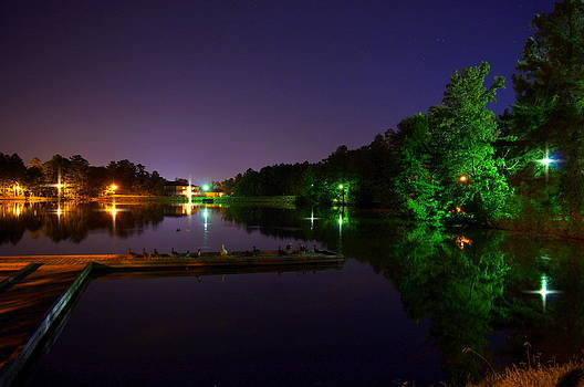 Reflections at Lake Midnight  by Walter  Holland