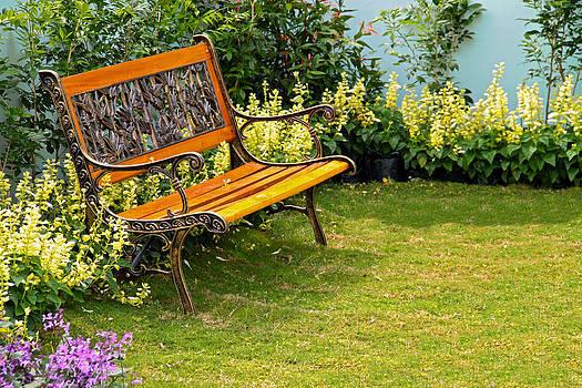 Relaxing bench at a garden by Calvin Chan