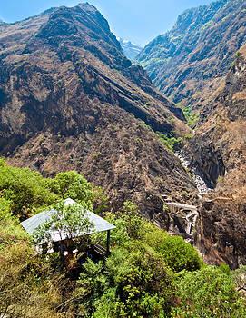 Resting hut at Tiger Leaping Gorge near Shangri-la Yunnan China by Calvin Chan