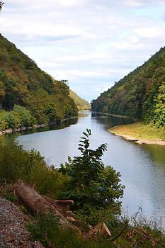 River is in between by Renee Braun