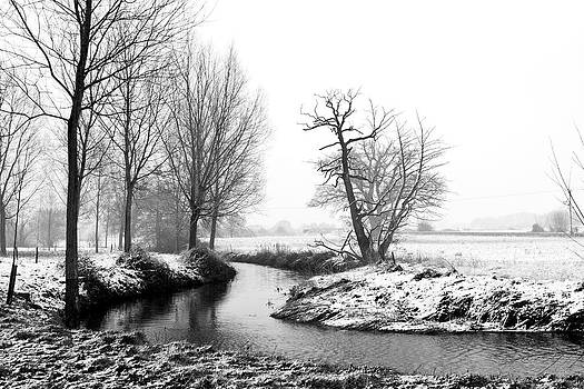 Fizzy Image - river running through a winter snow scene