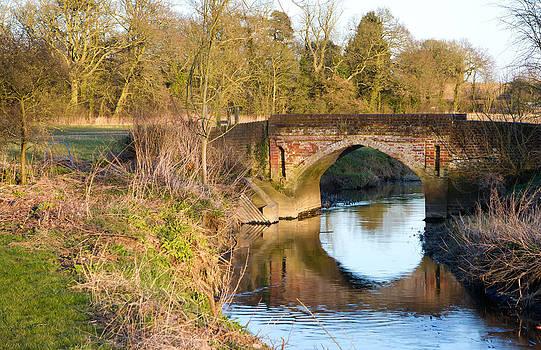 Fizzy Image - river running under a bridge