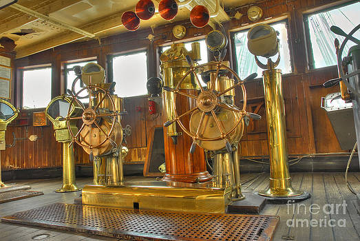 David Zanzinger - RMS Queen Mary Bridge well-polished brass annunciator controls and steering wheels