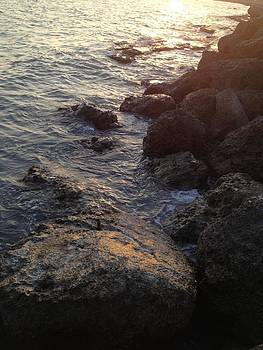 Rocks at sunset by Tommy Mazza
