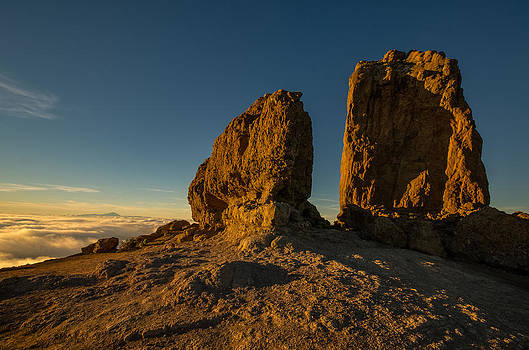 Roque Nublo farther and sun monoliths at sunset by Ben Spencer