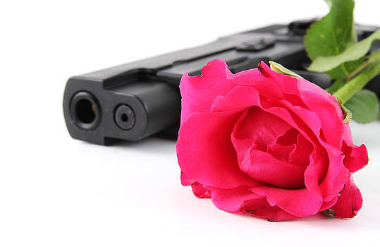 Rose and pistol by Pong Am