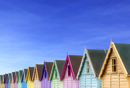 Fizzy Image - row of beach huts with a deep blue sky