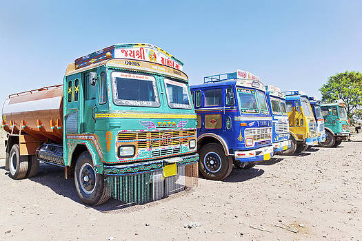 Kantilal Patel - Row of colorful Indian trucks parked at a Dhabha