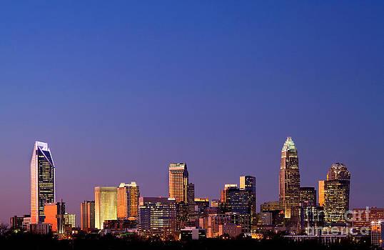 Royal blue skyline of Charlotte NC by Patrick Schneider