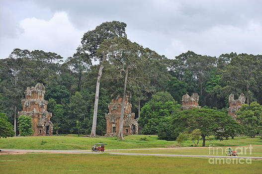 Ruins and tourists at Angkor Wat by Sami Sarkis
