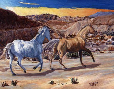 Running horses by Darlene Luckins