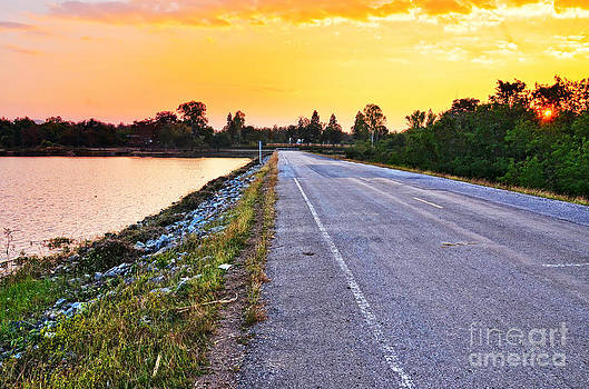 Rural road near river and nice sunset by Jeng Suntorn niamwhan