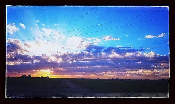 Rural Sunset by Nicholas Gratzl