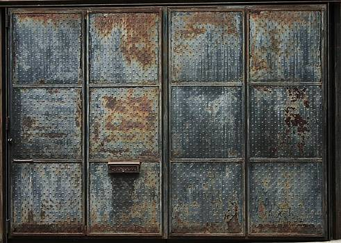 Robin Mahboeb - rusted metal doors