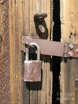 Rusty Lock by Marie-Pierre Sabga