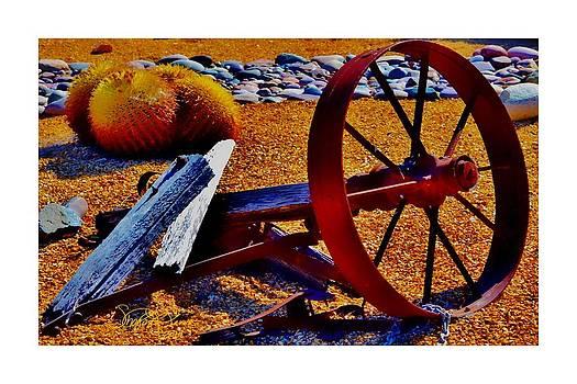 Rusty Wheel by Sharon  Lavoie