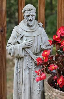 Saint Francis next to Bigonia Flower by Cynthia Snyder