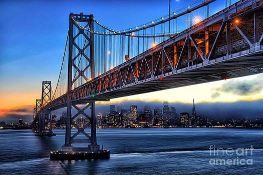 San Francisco Skyline under the Bay Bridge by Peter Dang