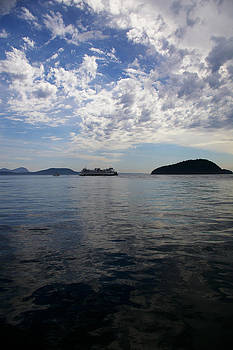 San Juan Island Ferry with changing skies by Christine Burdine