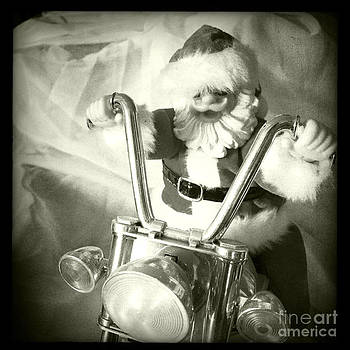 Santa Rides His Motorcyle by Nina Prommer