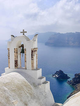 Santorini chapel facing the caldera by Christos Andronis