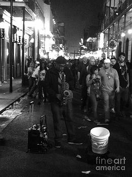 Sax player on Bourbon Street by WaLdEmAr BoRrErO