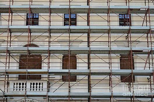 Scaffolding on building facade by Sami Sarkis