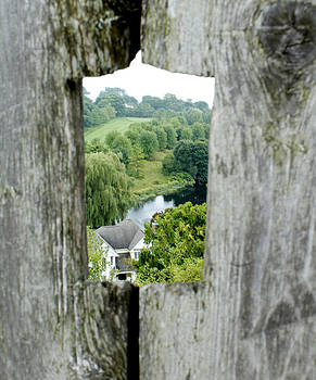 Scenic View Through The Hole In The Wood by Danielle Allard