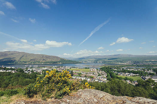 Scottish harbour town from top of a hill by Leander Nardin