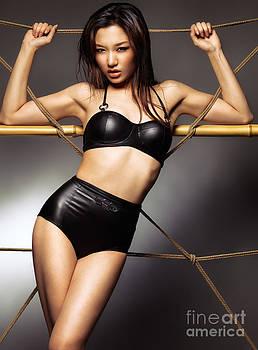 Sexy asian woman wearing stylish black bikini swimsuit by Oleksiy Maksymenko