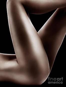 Sexy nude woman legs on black by Oleksiy Maksymenko