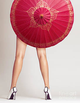 Sexy woman legs behind red Chinese umbrella by Oleksiy Maksymenko
