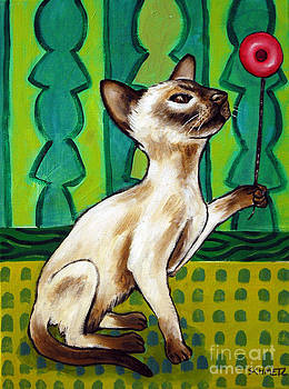 Siamese Cat Playing with a Yo-Y0 by Jay  Schmetz