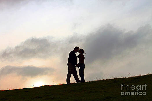 Silhouette Couple holding each other by Lars Ruecker