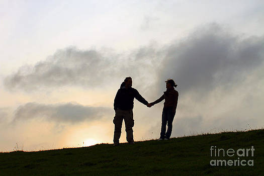 Silhouette Couple holdings hands by Lars Ruecker