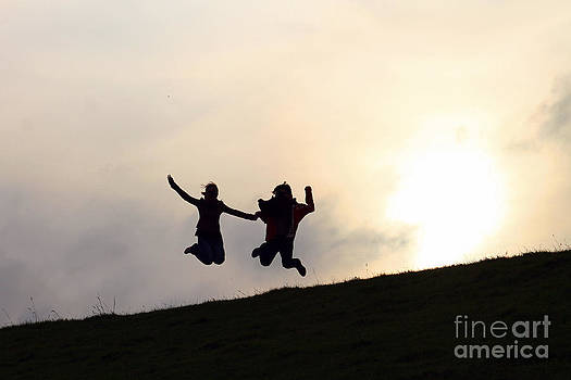 Silhouette Jumping Couple by Lars Ruecker
