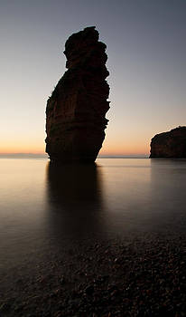 Silhouetted Stack at Ladram bay by Pete Hemington