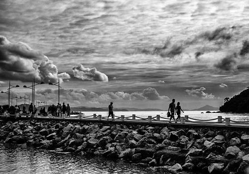 Silhouettes on the Jetty by Jose Maciel