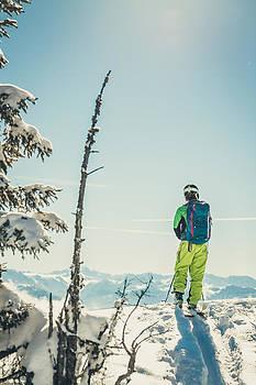 Skier in austian winter  landscape by Leander Nardin