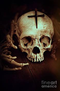 Sandra Cunningham - Skull with metal cross and skeleton hands