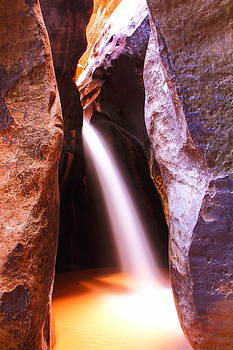 Slot Canyon Waterfall by Roupen  Baker