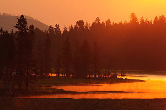 Smoky Sunrise at Yellowstone's Fishing Bridge by Bruce Gourley